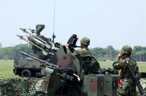 """Lực lượng quân sự Đài Loan đồn trú bất hợp pháp trên đảo Ba Bình trong quần đảo Trường Sa thuộc chủ quyền Việt Nam, núp dưới danh nghĩa """"cảnh sát biển""""."""