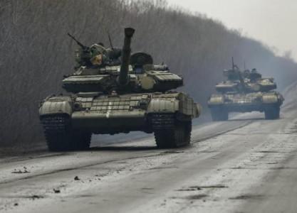 Members of the Ukrainian armed forces ride in tanks near Artemivsk