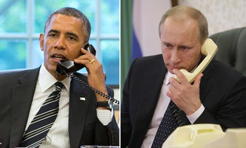 Tổng thống Mỹ Barack Obama (trái) và người đồng cấp Nga Vladimir trong một cuộc điện đàm. Ảnh: Reuters/RIA Novosti.