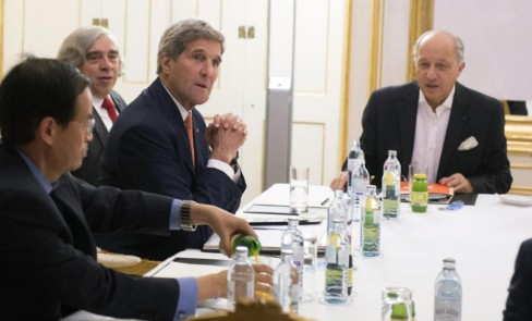 US Secretary of State John Kerry, second right, US Secretary of Energy Ernest Moniz, second left, and French Foreign Minister Laurent Fabius, right, meet at Palais Coburg Hotel, where the Iran nuclear talks are being held, in Vienna, Austria, Tuesday, July 14, 2015. After 18 days of intense and often fractious negotiation, diplomats Tuesday declared that world powers and Iran had struck a landmark deal to curb Iran's nuclear program in exchange for billions of dollars in relief from international sanctions, an agreement designed to avert the threat of a nuclear-armed Iran and another U.S. military intervention in the Muslim world. (Joe Klamar/Pool Photo via AP)