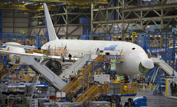 A Boeing 787 sits on the assembly line at the company's operations in Everett, Washington in this file photo taken October 18, 2012. The Commerce Department said on Thursday durable goods orders, items ranging from toasters to aircraft that are meant to last three years or more, dropped 18.2 percent, the largest decline since the series started in 1992. That partially reversed July's aircraft-driven 22.5 percent surge.   REUTERS/Andy Clark/Files  (UNITED STATES - Tags: TRANSPORT BUSINESS)