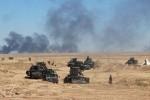 Lực lượng an ninh Iraq thực hiện chiến dịch quân sự đang di chuyển tiến về thị trấn Hit ở phía tây Ramadi, ngày 08 tháng 3 năm 2016. REUTERS / Stringer